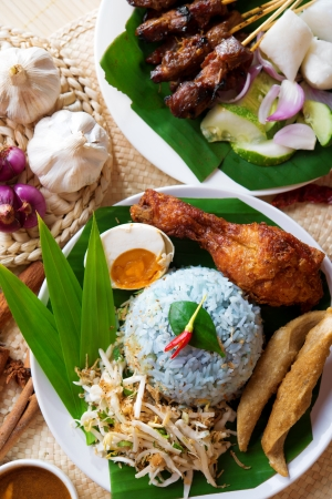 Nasi kerabu, popular Malaysian Malay rice dish. Traditional east coast blue rice. Famous in states such as Terengganu or Kelantan . Malaysia food, Asian cuisine. photo