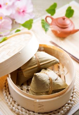 dumpling: Rice dumpling or zongzi. Traditional steamed sticky  glutinous rice dumplings. Chinese food dim sum. Asian cuisine.  Stock Photo