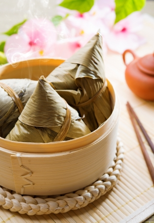 dumpling: Hot rice dumpling or zongzi. Traditional steamed sticky  glutinous rice dumplings. Chinese food dim sum. Asian cuisine.