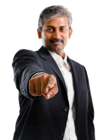 Good looking mature Asian Indian business man with business suit finger pointing isolated on white background photo
