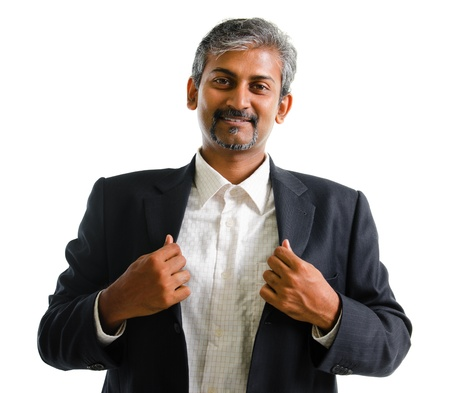 male age 40's: Good looking mature Asian Indian business man with business suit smiling isolated on white background