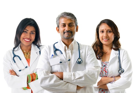 doc: Group of Indian medical doctors, male and female standing isolated on white background. Stock Photo