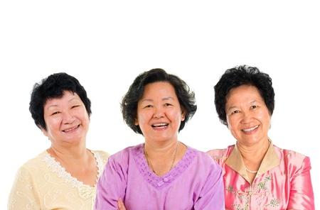 Three Asian senior women smiling happily isolated on white background.