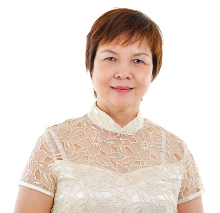Modern mature Asian woman smiling over white background. photo