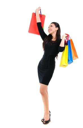 Asian shopping woman happy smiling holding many shopping bags photo