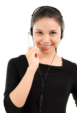 Telemarketing headset woman in black suit from call center smiling happy talking in hands free headset device photo