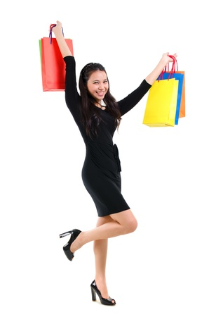 Excited Asian shopping woman happy smiling holding many shopping bags photo
