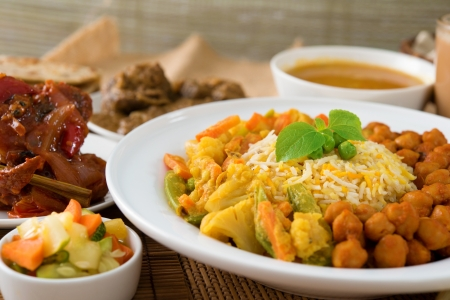 Biryani rice or pilau rice with curry, fresh cooked basmati rice with spices, delicious Indian food. Stock Photo