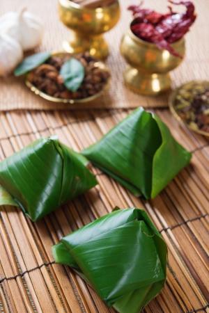 Nasi lemak, popular traditional Malaysian food wrapped with banana leaf. photo