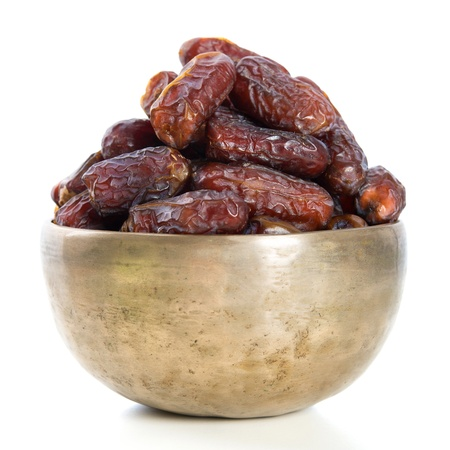 Dates.  Kurma dried date palm fruits, Ramadan food which eaten in fasting month for Muslim. Pile of fresh dried date fruits in a bowl. photo