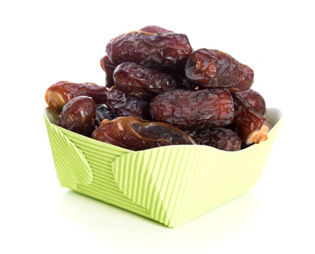 Kurma dried date palm fruits, ramadan food which eaten in fasting month. Pile of fresh dried date fruits in paper box. photo