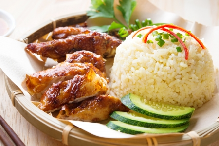 Malaysia grilled chicken rice. Asian style Hainan chicken rice close-up. Asian food. Stock Photo