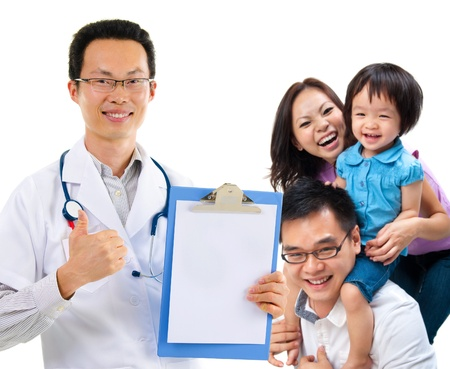 community health care: Smiling friendly Chinese male medical doctor and young patient family. Health care concept. Isolated on white background.