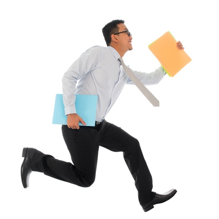 Full body young Asian businessman in hurry running or jumping up with some file and documents in his hand, isolated on white background photo