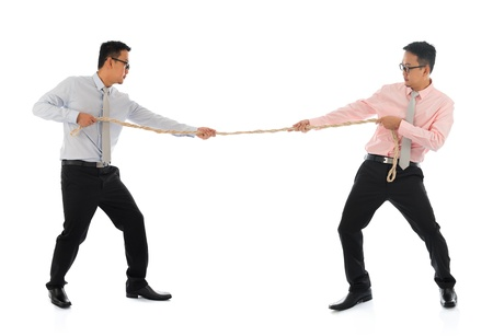 office force: Full body two Asian businessmen pulling a rope, isolated on white background. Asian male model.