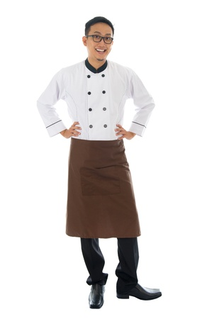 full uniform: Portrait of full body Asian male chef, standing isolated on white background Stock Photo