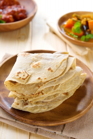 Chapati or chapatti, Indian dhal and chicken curry, popular Indian food. photo