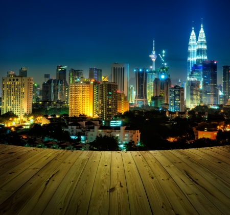 night life: Kuala Lumpur city view and wooden floor.