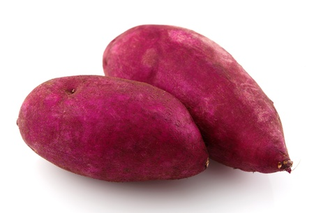 Pair of raw sweet potatoes isolated on white. photo