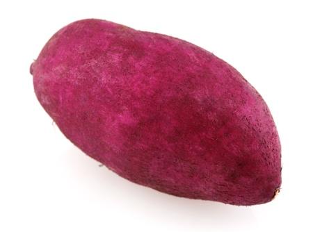 potato plant: Single raw sweet potato isolated on white.