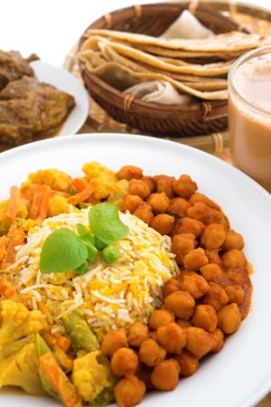 tarik: Indian food biryani rice, mutton curry, chapatti and milk tea. Indian dining table.