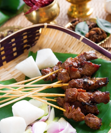 satay sauce: Beef satay, roasted meat skewer Malay food. Traditional Malaysia food. Hot and spicy Malaysian dish, Asian cuisine.