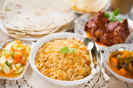 tarik: Indian meal biryani rice, chicken curry, masala milk tea, acar vegetable, roti chapatti and papadom. Stock Photo
