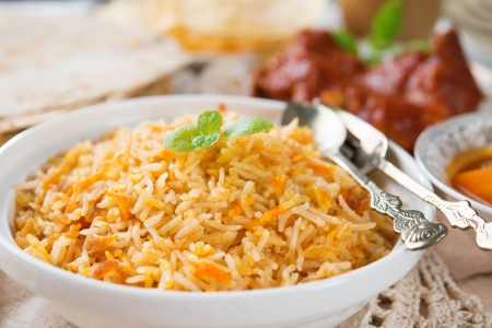 Biryani rice or briyani rice, fresh cooked, traditional indian food on dining table. photo