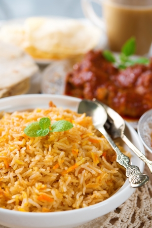 tarik: Indian cuisine biryani rice and chicken curry.