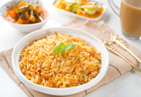 biryani: Indian vegetarian food. Biryani rice, curry dhal and milk tea on dining table.