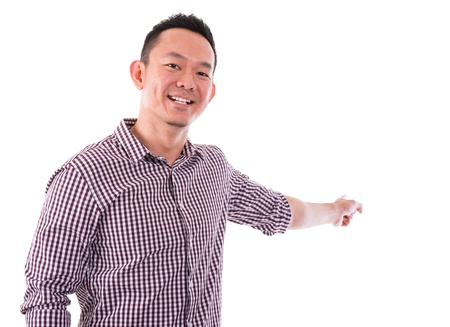 Portrait of a happy business man of Asian male finger pointing something isolated on white background. photo