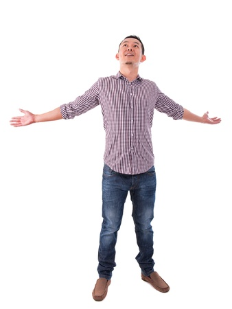 Happy Asian man arms opened looking up. Full body standing isolated on white background. Asian male model. photo