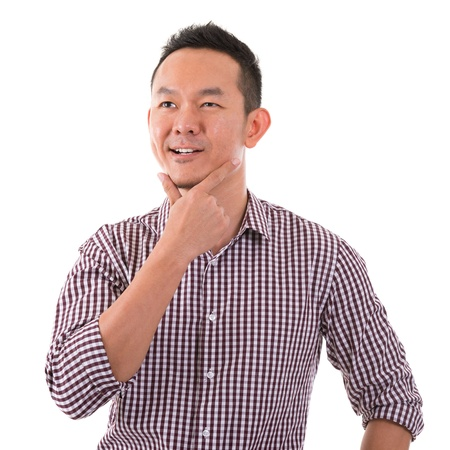 think positive: Portrait of casual Asian man having a thought, isolated on white background. Asian male model.