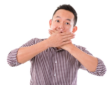 big mouth: Asian man with big surprise expression, hand covering mouth, isolated on white background. Asian male model. Stock Photo