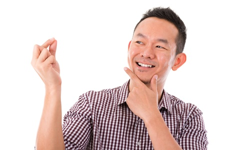 Asian man hand holding blank sign with happy face expression, isolated over white background. Asian male model. photo