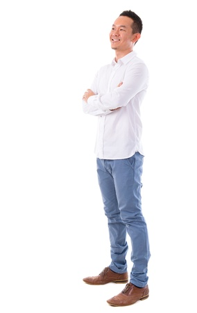 Front view full body happy Asian man looking at side standing isolated on white background. Asian male model. photo