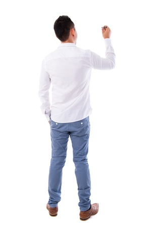 Rear or back view full body picture of an Asian male in white shirt writing something on glass board with marker