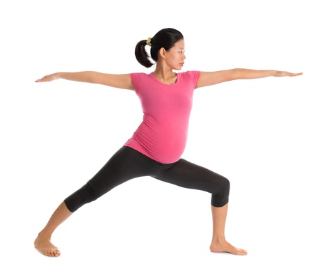 prenatal care: Prenatal yoga class. Full length healthy Asian pregnant woman doing yoga exercise stretching at home, fullbody isolated on white background. Yoga positions warrior pose 2.