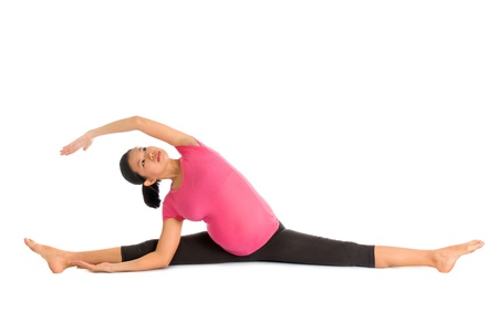Prenatal yoga. Full length Asian pregnant woman doing gymnastic stretching, fullbody isolated on white background. photo