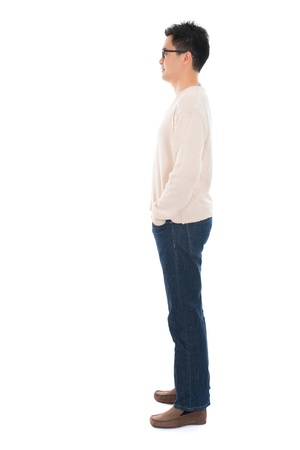 Side view full body casual Asian man standing isolated on white background photo