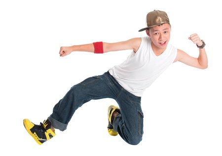 Full body cool looking Asian teen hip hop dancer dancing isolated on white background. Asian youth culture. photo