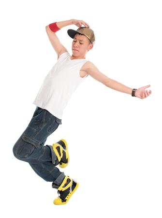 Full body funky uitziende Aziatische tiener hip hop danser op een witte achtergrond. Aziatische jeugdcultuur. Stockfoto