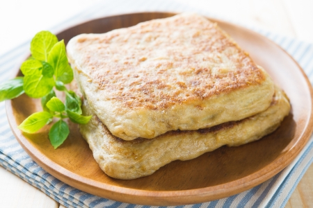 Martabak or murtabak, also mutabbaq, is a stuffed pancake or pan-fried bread which is commonly found in Saudi Arabia,  Yemen, India, Indonesia, Malaysia, Thailand, Singapore, and Brunei. Stock Photo