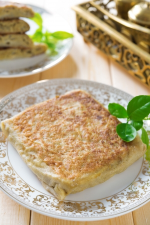 Martabak or murtabak, also mutabbaq, is a stuffed pancake or pan-fried bread. Stock Photo - 21373911