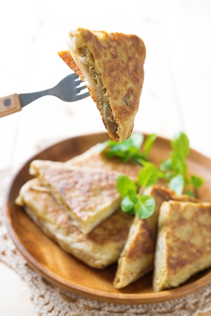 Malaysian food murtabak usually sold in Indian Muslim restaurants and stalls , stuffed with minced mutton, garlic, egg and onion, and is eaten with curry gravy. Stock Photo - 21373918