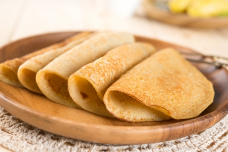 homemade style: Asian style homemade banana pancakes or crepe on dining table. Stock Photo