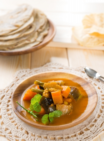 Vegetable curry dhal, chapatti roti or Flat bread and papadom. Indian food on dining table. photo