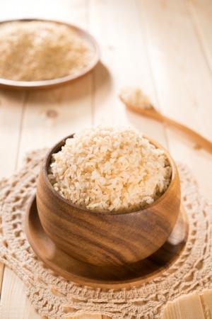 basmati: India organic basmati brown rice in wooden bowl on dining table.