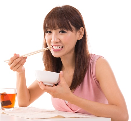 chopstick: Portrait of Asian woman eat rice isolated on white background. Asian female model.