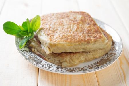 Martabak or murtabak, also mutabbaq, is a stuffed pancake or pan-fried bread. Stock Photo - 21373951